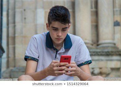 young-teenage-man-mobile-phone-260nw-1514329064